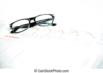 Glasses on a financial newspaper
