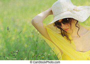 sunny day - young woman in field on a summer day
