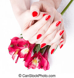 Closeup image of red manicure with flowers - beautiful;...