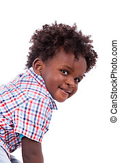 Portrait of a cute black baby boy, isolated on white...