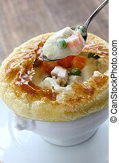 chicken pot pie - hot creamy stew in lion head soup bowl