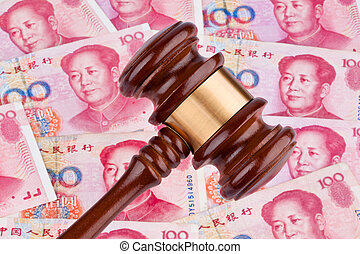 chinese yuan banknotes and gavel. costs for the rule of law