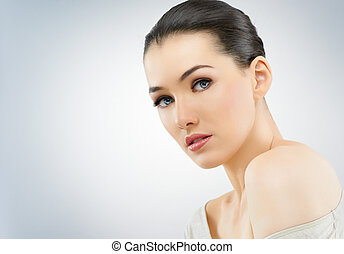 beauty portrait - a beauty girl on the blue background