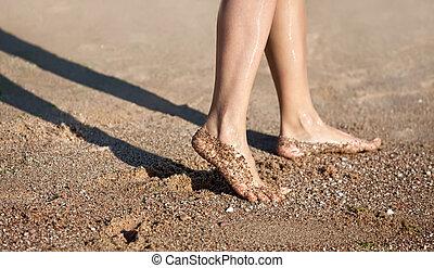 legs on the sand beach - Girl's barefoot legs on the sand...