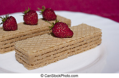 Sweet confectionery wafers with berries of fresh wild...