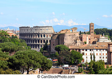 Rome, Italy - skyline with Colosseum UNESCO World Heritage...