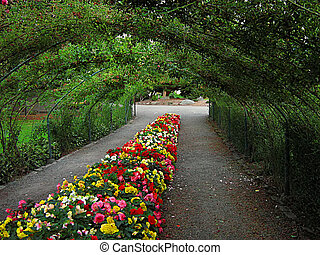 Garden Landscape - A photograph of a flower garden located...