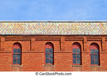 Brick Building - Slate roof and arch windows on brick...