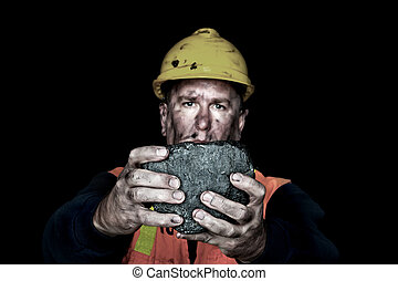 Lump of coal - A coalminer holds out a large chunk of energy...