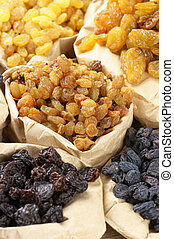 Assorted raisins - Various raisins in paper bags Full frame...