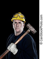 Construction worker with sledgehammer - A manual laborer...