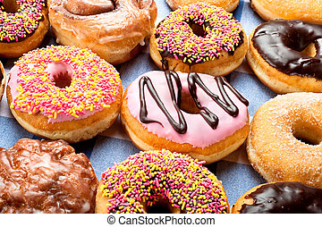 Donuts - Close up of a selection of colorful donuts Focus is...