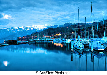 Boats on Lake Thun Bernese Oberland Switzerland