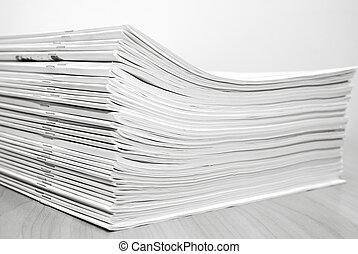 Stack journals - Stack of white journals on table, closeup...
