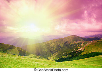 Beautiful evening sky and green hills high up in Carpathian...