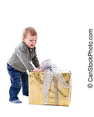 Boy with gift isolated - Adorable toddler boy with big gift...