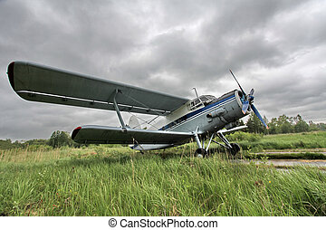 Biplane on the airfield side view