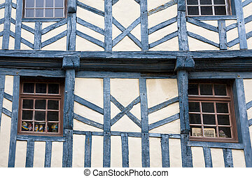 wall of medieval timber framing house in Treguier, Brittany,...