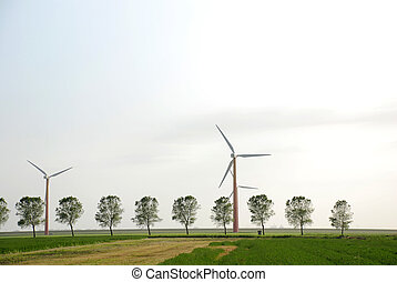 Green energy - Windturbines producing clean energy in the...