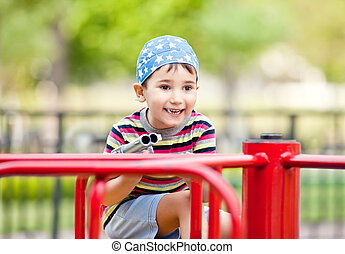 boy with toy gun - Cute smiling young boy with toy gun