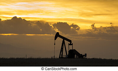Pumpjack - A pumpjack silhoutte with dramatic sunset.