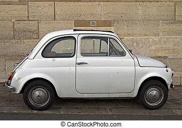 Old Fiat 500 - Old white Fiat 500 on Paris street.
