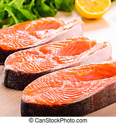 Salmon steak raw - Raw salmon steak in row, prepared for...