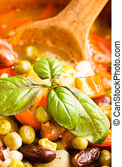 Minestrone soup in wooden bowl closeup. Traditional italian...