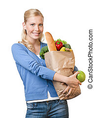 Young pretty woman with a bag full of healthy eating