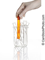 Flask with a hand holds yellow test tube