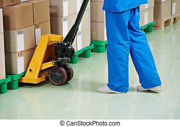 medical warehouse works by lifting stacking equipment and...