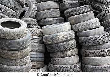 background with old tires on each other