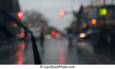 Rainy intersection. - Looking through a windshield at...
