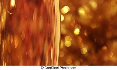 Champagne against a gold fur-tree