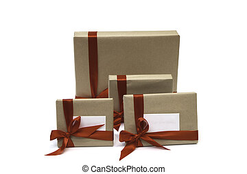 4 wrapped gifts - 4 gifts that have been wrapped in brown...
