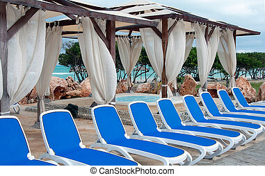 Jacuzzi and blue sunbeds in the caribbean - Jacuzzi in the...