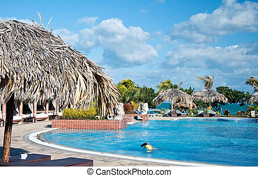 Luxury swimming pool by beach hotel in Varadero, Cuba - A...