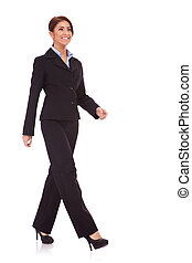 business woman walking - full body picture of a business...