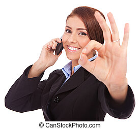 business woman with phone and ok gesture