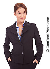 business woman with hands in her pockets - Happy young...