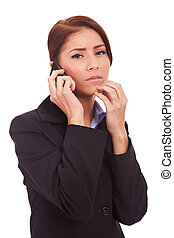 business woman worries onthe phone - business woman worries...