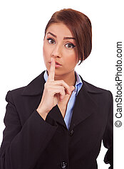business woman making quiet gesture - portrait of attractive...