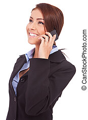 young business woman talking on mobile - side view of a...