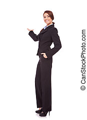 young business woman presenting something - full body...