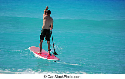Man paddling out on paddle board - Man on Paddle Board...