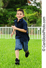 Happy young Boy running - Happy young Child running on grass...