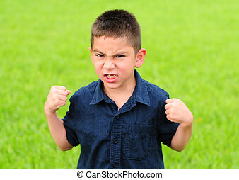 Angry young boy - Young boy who is angry with his fists...
