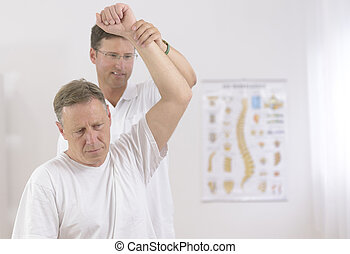 Physiotherapy: Senior man and physiotherapist at office