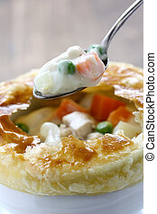 chicken pot pie - hot creamy stew in lion head soup bowl