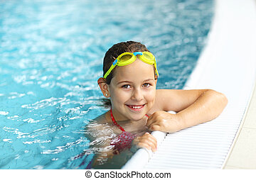 Girl with goggles in swimming pool - Cute girl with goggles...